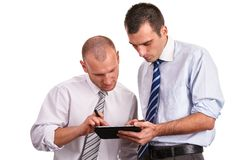Two businessmen in shirts, looking down with confidence and cons Stock Images