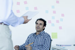 Two businessmen sitting and talking in the office Royalty Free Stock Photo