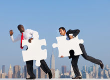 Two Businessmen Solving A Puzzle Royalty Free Stock Photos