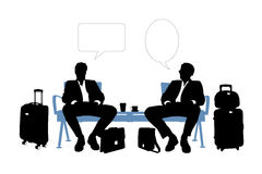 Two businessmen speaking in the airport lounge Stock Images