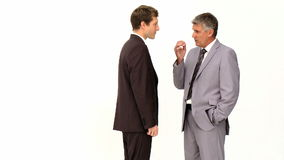 Two businessmen speaking. Isolated on a white background stock video footage