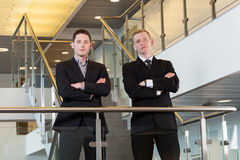 Two businessmen standing with arms crossed Royalty Free Stock Photos