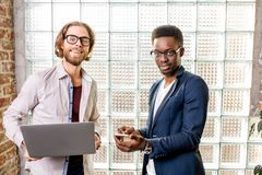 Two businessmen standing in the loft office stock photos