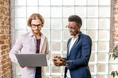 Two businessmen standing in the loft office stock photo