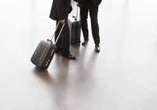 Two businessmen standing with suitcases Royalty Free Stock Images
