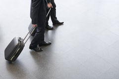 Two businessmen standing with suitcases Royalty Free Stock Photography