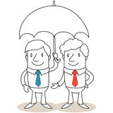 Two businessmen standing under umbrella Stock Photos