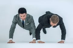 Two businessmen at the starting position. Competition concept Royalty Free Stock Image
