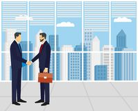 Two businessmen in suits shaking hands. To sign a contract . The concept of a successful transaction Stock Photography