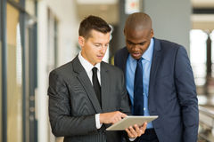 Two businessmen tablet computer royalty free stock photography