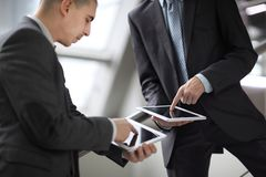 Close up. two businessmen with tablet computers. Two businessmen with tablet computers royalty free stock image