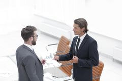 Two businessmen talking in the office. Royalty Free Stock Photography