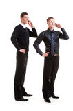 Two businessmen talking on the phone Royalty Free Stock Images