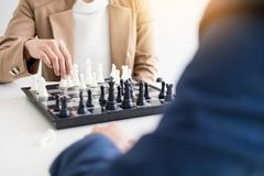 two businessmen thinking Strategy of move while playing chess co royalty free stock images