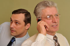 Two businessmen together and talk on the phone Royalty Free Stock Image