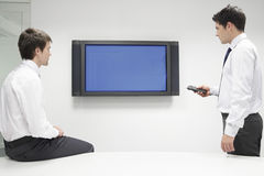 Two Businessmen Using Flat Screen Monitor Stock Photo