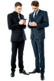 Two businessmen using the phone Royalty Free Stock Photos