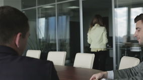 Two businessmen are waiting for a new contract in a meeting hall. stock video