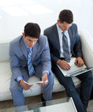 Two businessmen in a waiting room Royalty Free Stock Photos