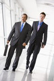 Two businessmen walking Stock Images