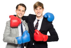 Two businessmen wearing boxing gloves Stock Photo