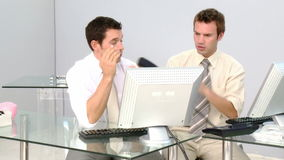 Two businessmen working at a computer. In the office stock video