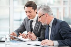 Two businessmen working with documents Royalty Free Stock Photos