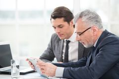 Two businessmen working with documents Royalty Free Stock Images