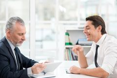 Two businessmen working with documents Stock Photo