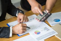 Two businessmen working on graphs in office, Business accounting royalty free stock photo