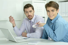 Two businessmen working on a laptop Stock Image