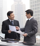 Two businessmen working outside Stock Images
