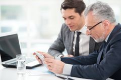 Two businessmen working with tablet computer Royalty Free Stock Images