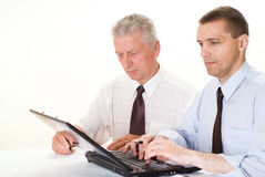 Two businessmen working together Stock Images