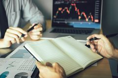 Free Two Businessmen Working Together Are Analyzing The Company`s Performance Graph Stock Photo - 138977850