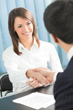Two businesspeople. Or business person and client handshaking royalty free stock photography