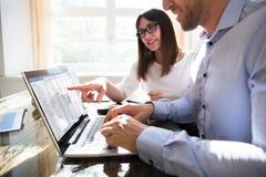 Two Businesspeople Analyzing Gantt Chart stock photos