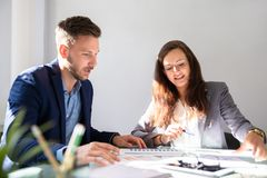 Two Businesspeople Analyzing Graph stock image