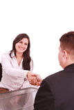 Two businesspeople, or business person and client. Handshaking at office stock image