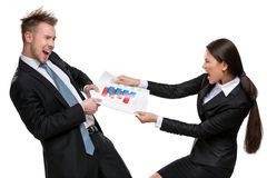 Two businesspeople can't share the document Royalty Free Stock Images