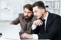 Two businesspeople discussing project Stock Photography