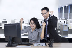 Two businesspeople expressing their achievement Stock Photos