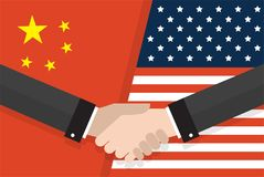 Two businesspeople handshake after good deal in front of an American and Chinese flag. two flags face to face, symbol. For the relationship between the two Stock Image
