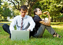 Two businesspeople have a break. At the grassland Royalty Free Stock Images