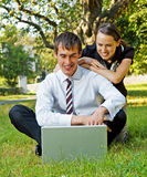 Two businesspeople have a break stock image