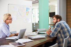 Two Businesspeople Having Creative Meeting In Office Royalty Free Stock Images