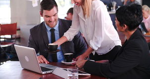 Two Businesspeople Having Meeting In Coffee Shop. Businessman and businesswoman having discussion in cafe - waitress brings them cups of coffee..Shot in 4k on stock footage