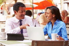 Two Businesspeople Having Meeting In Outdoor Caf� Royalty Free Stock Photo