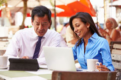 Two Businesspeople Having Meeting In Outdoor Caf� Royalty Free Stock Images