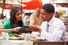 Two Businesspeople Having Meeting In Outdoor Restaurant Stock Images